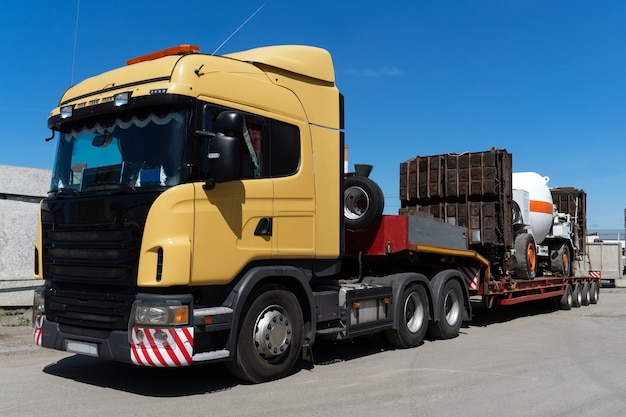 Oversized heavy transportations by truck. high industrial cargo shipped on the trawl.
