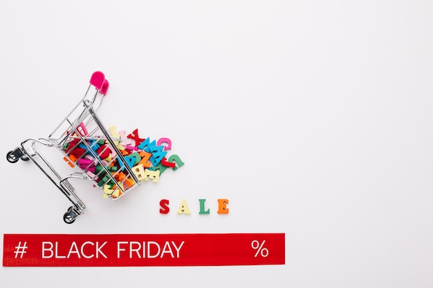 Overturned shopping cart with black friday ribbon