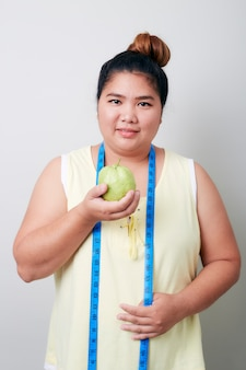 Overweight woman eating food