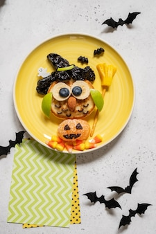 Owl pancake with fruits for kids breakfast on halloween