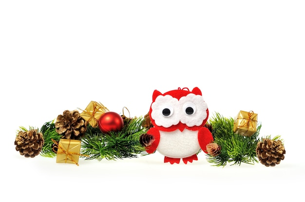 Owl with christmas tree with gifts and cones.