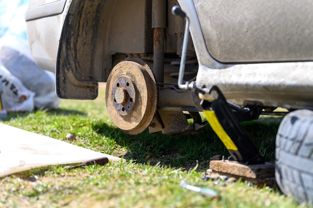Own repair of car drum brake himself. repair of broken car drum brake disassembled outdoor