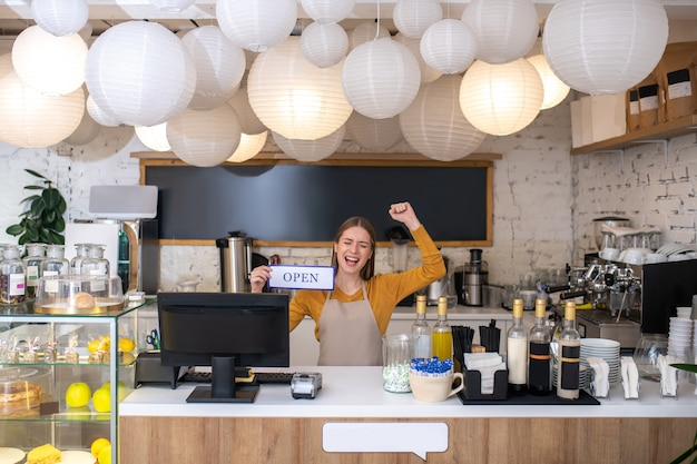 The owner feeling happy because of opening a new cafe