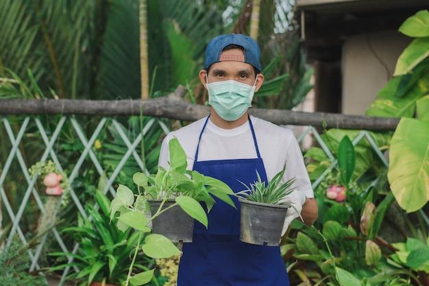 Owner shop ornamental plant holding pot in shop