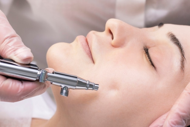 Oxygen mesotherapy. aquapilling. cosmetic peeling procedure. non-injection mesotherapy for a young girl in a beauty salon.
