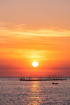 Oyster farm in the sea and beautiful sky sunset background