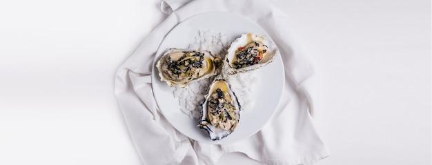 Oyster rockefeller and sake-poached oyster