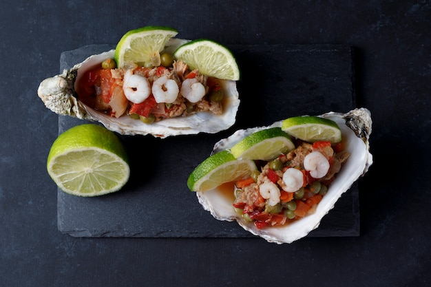 Oyster shell with seafood salad and lime