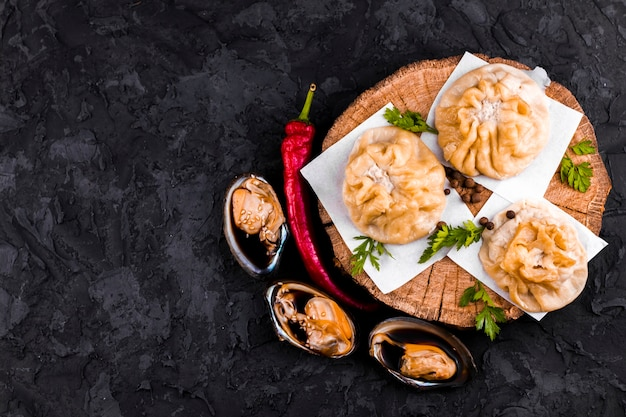 Oysters and dumplings plate with copy space