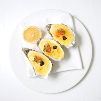 Oysters with sauce and lemon