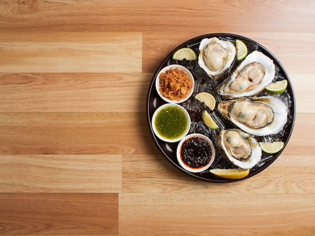 Oysters with thai-style spicy sauce.