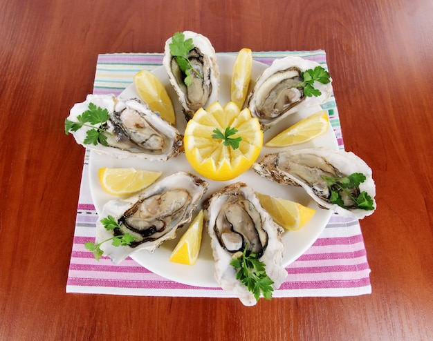 Oysters on wooden surface