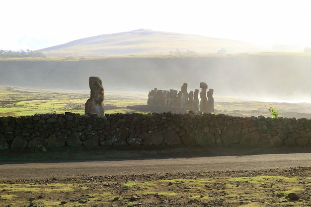 Pacific ocean spray blowing onto ahu tongariki, easter island, chile