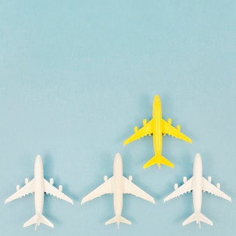 Pack of airplane toys with only a yellow one