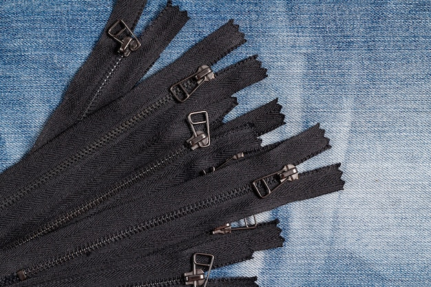 Pack of black metal antique zippers stripes with sliders