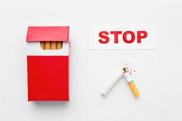 Pack of cigarettes with message stop smoking