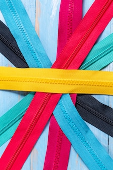 Pack of colorful plastic zippers pattern