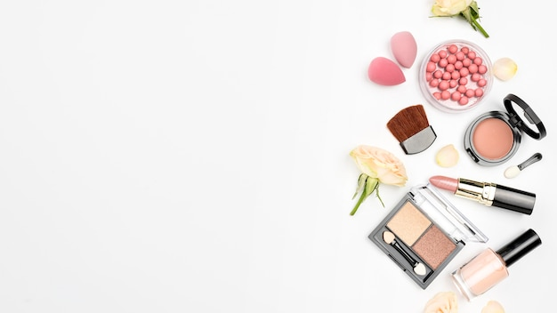 Pack of different cosmetics with copy space on white background