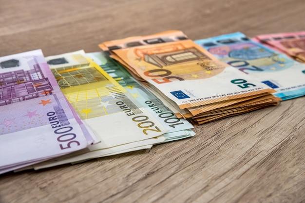 Pack of euros bills on desk. close up