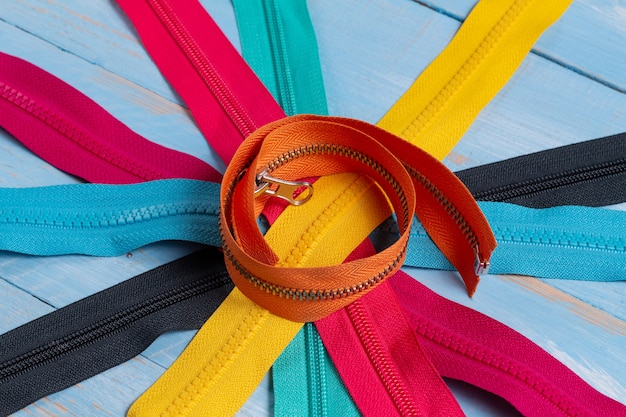 Pack lot of colorful plastic and metal zippers stripes
