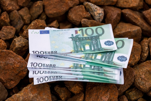 A pack of money lying on the road out of gravel. high quality photo