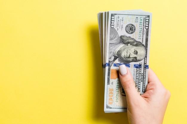 Pack of one hundred dollar bills in female hands