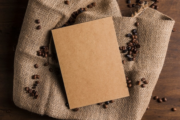 Package and coffee beans on sackcloth