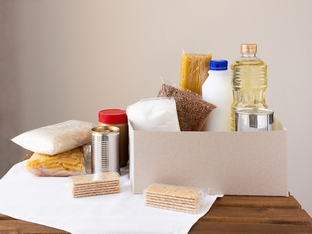 Packaged food on wood table and in a box.