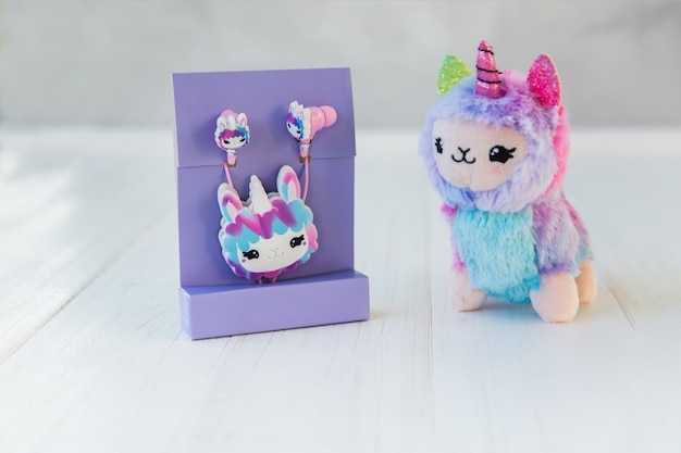 Packaged llama unicorn headphones for kids in purple pack