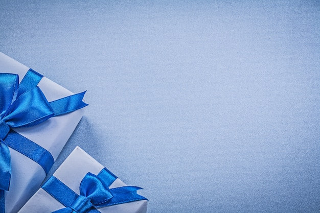 Packaged present boxes on blue background greeting card