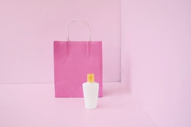Packaging concept with pink shopping bag