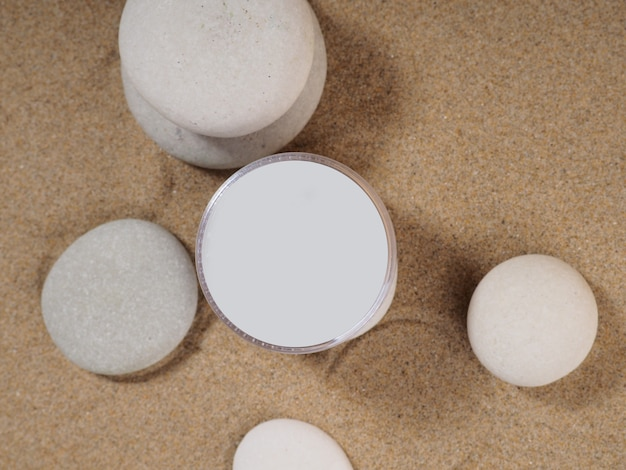 Packaging with sand bottle stone. travel, vacation concept. sun protection cream. summer concept. cosmetic lotion background. beach summer background.