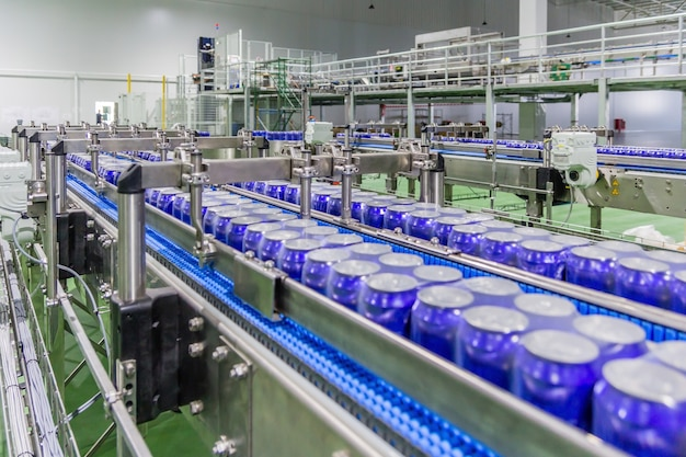 Packed cans on the conveyor belt in beverage factory