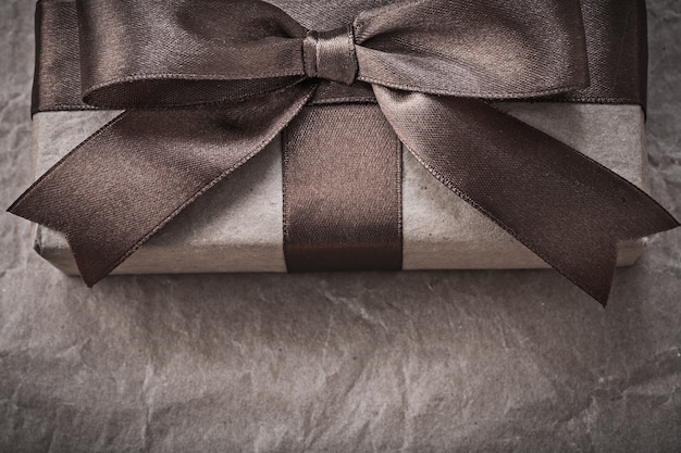Packed gift box on wrapping paper