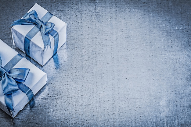 Packed giftboxes on metallic background celebrations concept