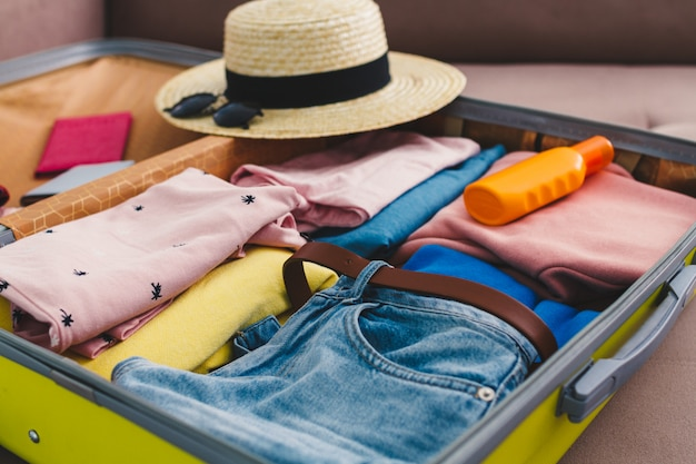 Packing a luggage at home for a new journey and travel. vacation travel suitcase