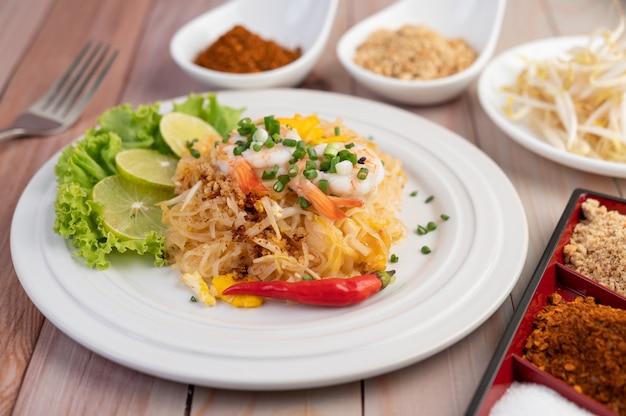 Pad thai fresh shrimp in a white plate.