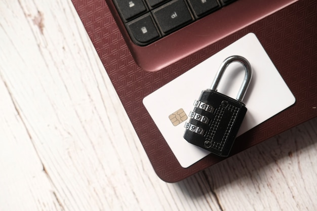 Padlock on credit card, internet data privacy information security concept.