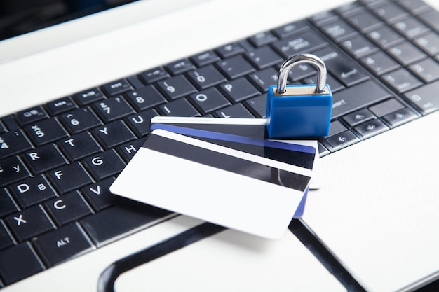 Padlock and credit cards on the computer keyboard. credit card security