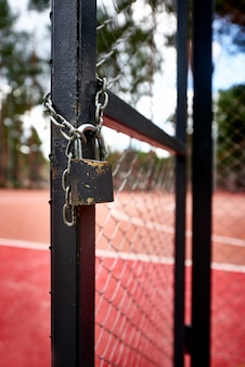 Padlock at the entrance of the basketball field