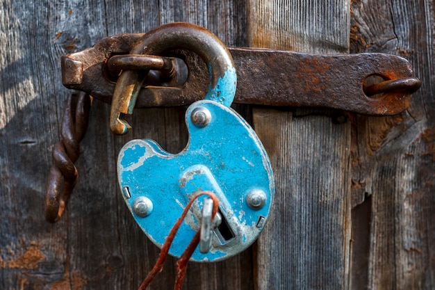 Padlock on the garage door. gate locked on the castle.