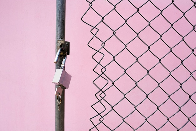 A padlock and a key at the wired gate