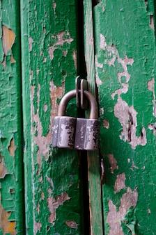 Padlock on an old wooden door
