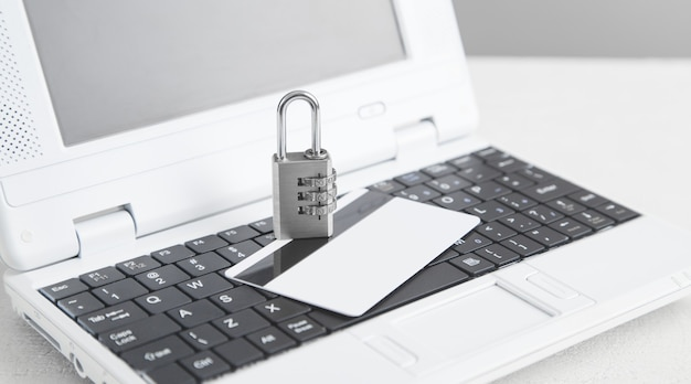 Padlock with credit card on the computer keyboard.