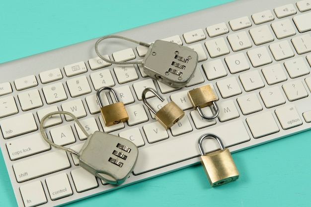 Padlocks over a computer keyboard. data protection on the internet