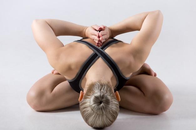 Padmasana with forward bend