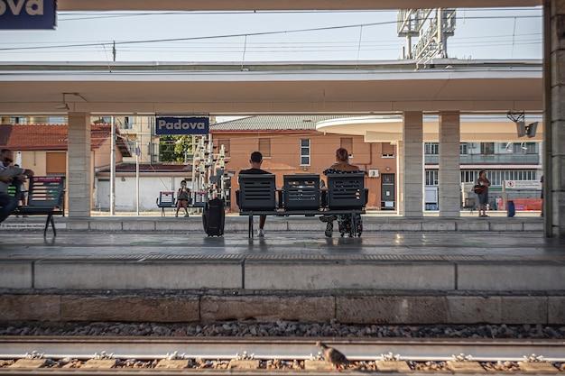 Padova, italy 17 july 2020: padua railway station with people
