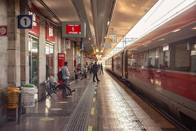 Padova, italy 17 july 2020: padua railway station with train and people