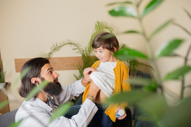 Paediatrician doctor examining a child in comfortabe medical office