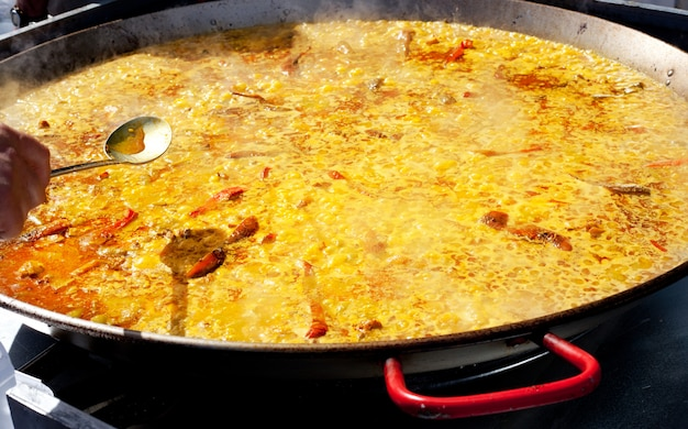 Paella rice from valencia spain cooking in big pan